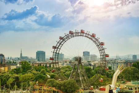 high park: VIENNA, AUSTRIA - APRIL 27TH 2011: Wiener Riesenrad in the Wurstelprater amusement park with Vienna downtown in the background. Editorial