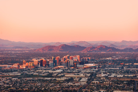 state of arizona: Phoenix Arizona with its downtown lit by the last rays of sun at the dusk.