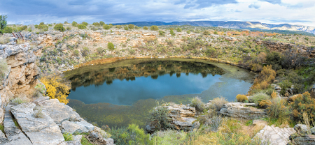 Montezuma Well is a natural sinkhole near the town of Rimrock, Arizona that has water even in the most severe drought.The Sinagua people, and possibly earlier cultures, used the water from the well to irrigate their crops. Stock Photo