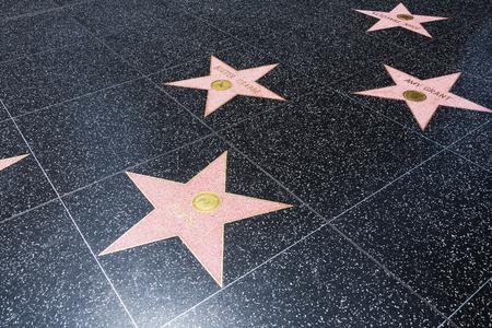 Hollywood boulevard: LOS ANGELES, CA - AUGUST 5, 2016: Slash, Amy Grant, Buster Crabbe, and John Travolta Walk of Fame stars on Hollywood Boulevard on August 5th 2016. Editorial
