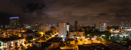 floridian: Panoramic night shot of Miami Beach, Florida, with Downtown Miami in the background. Stock Photo