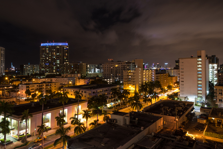 floridian: Long exposition night shot of Miami Beach, Florida, with Downtown Miami skyscrapers in the distance. Editorial
