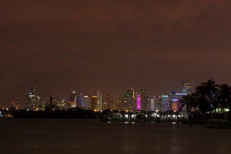 floridian: Long exposition night shot of Downtown Miami, Florida, seen from Miami Beach.