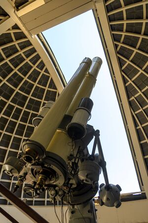 LOS ANGELES - AUGUST 6, 2016: Zeiss telescope at the Griffith observatory on August 6, 2016 in Los Angeles, USA. The Zeiss Refractor from 1935 is open to public and free due to Griffiths will.