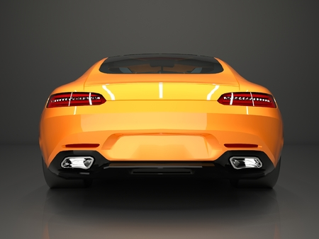 rear view: Sports car rear view. The image of a sports gold car on a gray background. Stock Photo