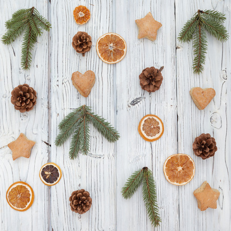 fur tree: Christmas decoration on old whitre grunge wooden board backgrond with fur tree, cookies, pine cone and citrus. Flat lay, top view