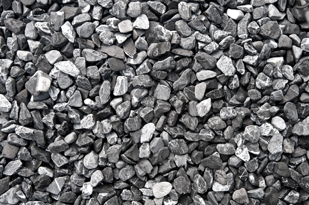 rock texture: Pattern grey gravel granite texture background for mix rock concrete pattern in construction industrial. Small gray pebble on ground or floor. Vintage and retro. Close up.