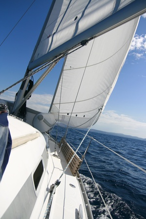 under sail in open sea Stock Photo