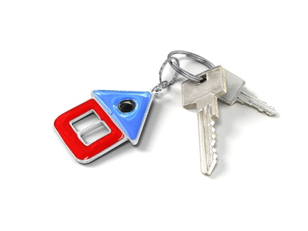 keys with charm in the form of a small house Stock Photo