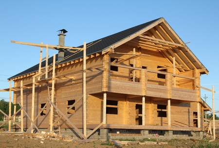 log on: wooden house under construction Stock Photo