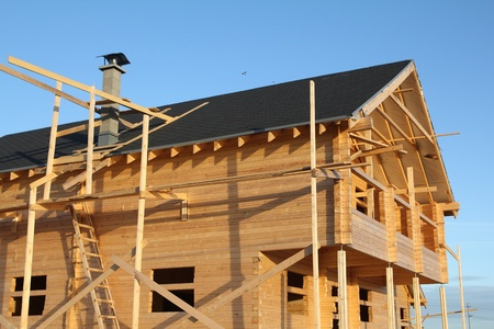 rafters: wooden house under construction Stock Photo