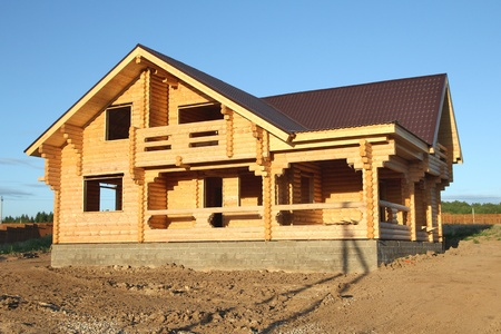 wooden house under construction photo