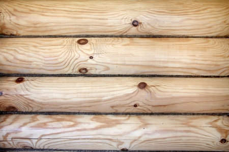 log house: A piece of a wall in a house made of logs. Wood texture