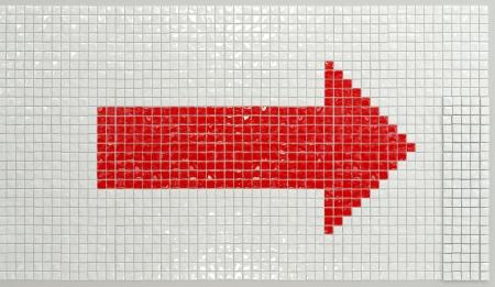 arrow sign made of glossy ceramic pieces photo