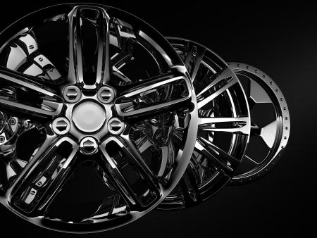 glossy metal car discs on black background