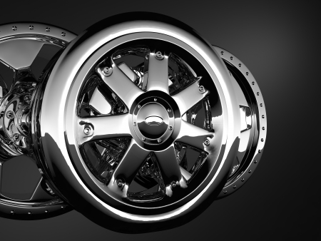 fine glossy chrome wheel discs over dark background photo