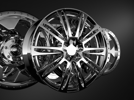 fine chrome car discs on dark background photo
