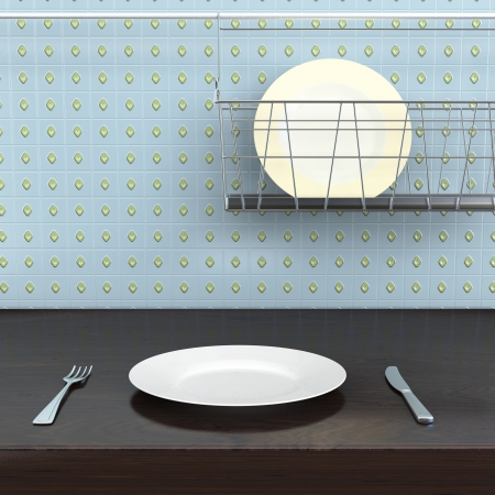 fork, knife and plate lying on the kitchen table Stock Photo - 22469650