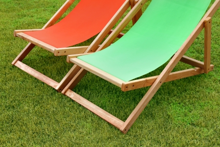 pair of lounge chairs standing on green grass Stock Photo - 22471511