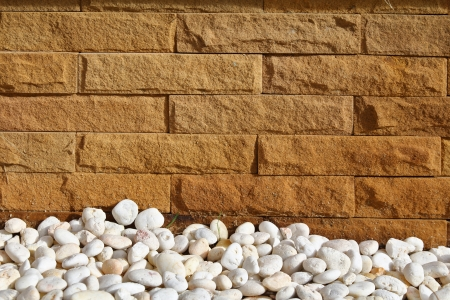 natural background with white pebbles and yellow bricks Stock Photo - 22471509