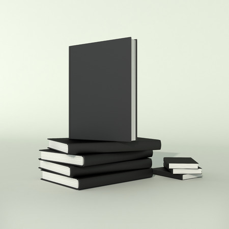 mag: stack of books in blank black hard covers on gray background