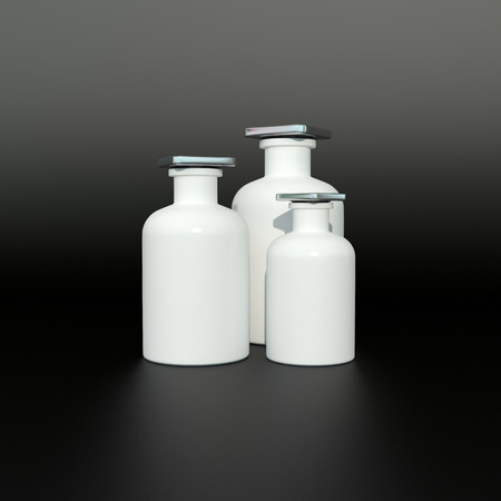 small white parfume bottles on black background photo