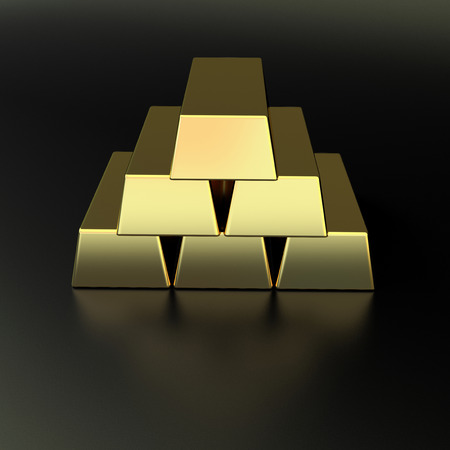 few golden bars made in a pyramid on black matted background photo