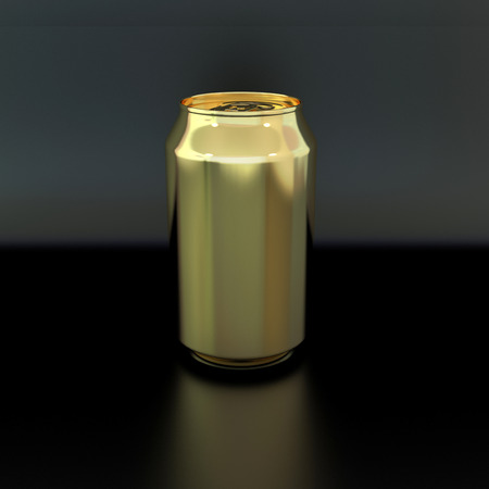blank golden can for soft drink or beer on dark background photo