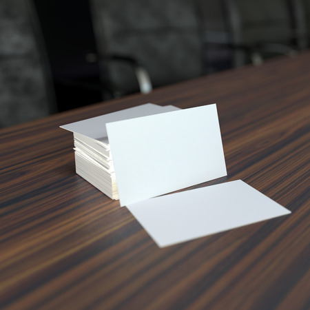 blank business card: a pile of blank white visit cards on wooden tabletop