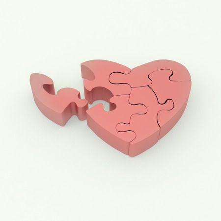 heart shape object made of pink matted puzzle on white background photo