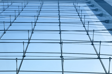 abstract architectural background with metal truss system and facade glasses photo