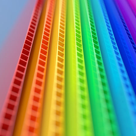 Stack of colorful corrugated plastic sheets close up view with depth of field