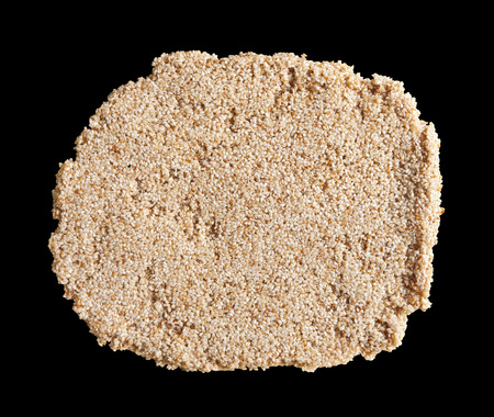 roasted sesame: fine roasted sesame seeds isolated on black background