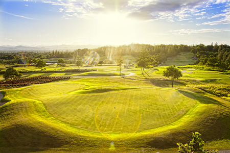 spectacular landscape with golf fields and sunset above