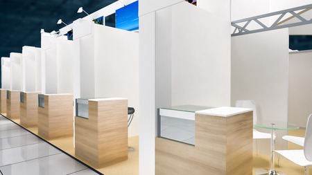exhibition pavilion interior with workplaces and white walls photo