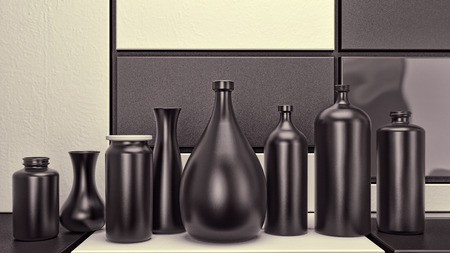 set of black ceramics bottles and cans in abstract interior photo
