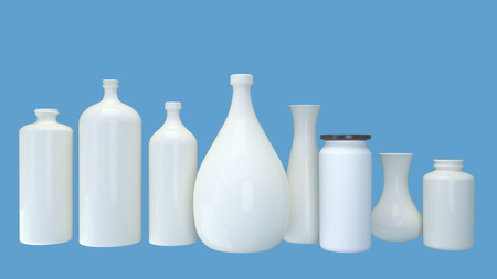 ceramic bottle: a set of different shape white bottles isolated on blue