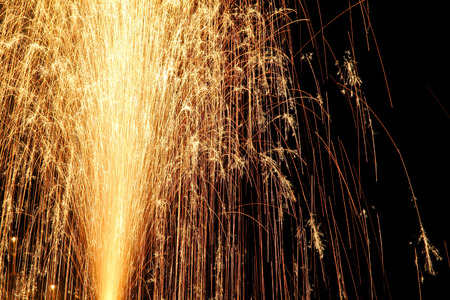 fire works: yellow festival fire works in night sky close up view