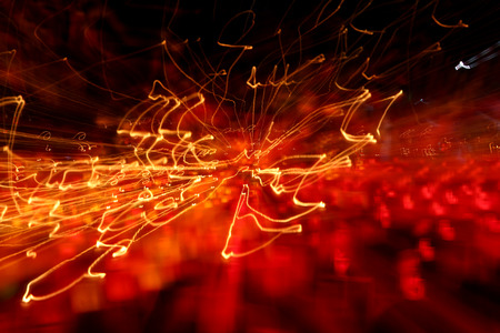 abstract zoom: abstract festive background with blurred red and yellow lights