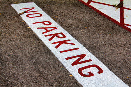 no parking: road sign no parking painted red Stock Photo
