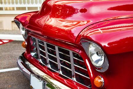 red vintage car exterior design elements close up view