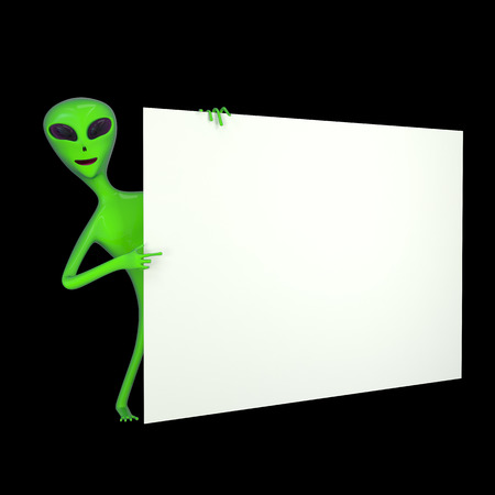 friendly green alien pointing with finger in white blank board photo