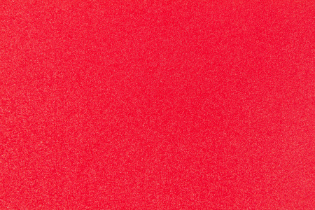 plastic texture: high resolution red grainy plastic texture close up view