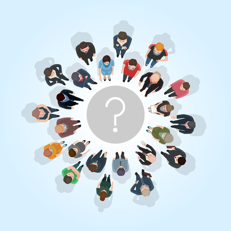 large group of people standing around a question mark