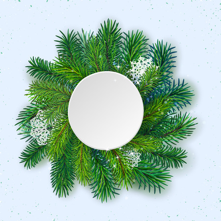 hoarfrost: high detailed pine branches forming frame around round label made of cardboard