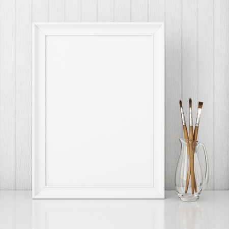 Vertical interior poster mock up with empty white frame and art brushes on wooden background. 3D rendering.