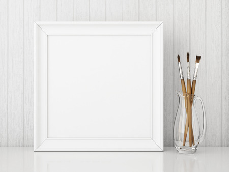 Square interior poster mock up with empty white frame and art brushes on wooden background. 3D rendering.