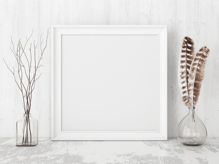 wooden surface: Square vintage poster mockup with wooden frame, feathers and twigs on empty white wall background. 3D rendering.