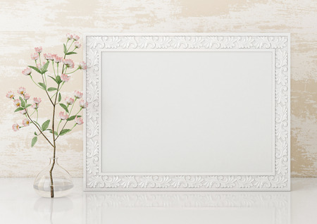 Horizontal interior mock up with empty white frame and blooming twig on wooden wall background. 3D rendering. Фото со стока