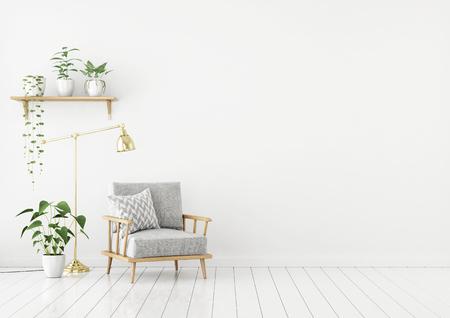 Salon de style scandinave avec fauteuil en tissu gris, lampe dorée et plantes sur fond de mur blanc vide. Rendu 3D.